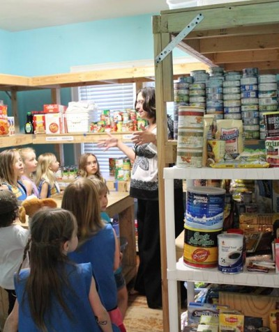 Girls Scouts learn about the food pantry.