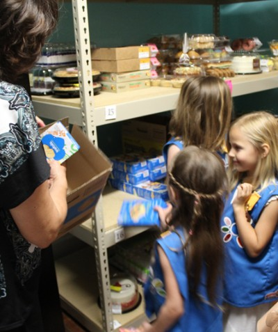 Girl Scouts donate cookies.